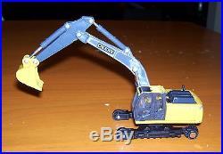 Diecast ERTL John Deere Excavator App. 2 1/2 Long Sold AS/IS